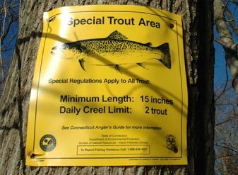 The regulation sign for fly fishing for sea run trout on the Saugatuck River in Westport Connecticut